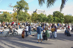 Street musicians and spectators Stock Image