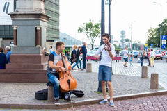 Street musicians on a Town hall square Royalty Free Stock Photography
