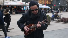 Street musicians. Two guys dresed like urban blues brothers playing guitars on the street in Zagreb, Croatia stock video footage