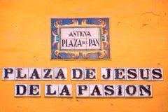 Street name on ceramic tiles in Seville Stock Images
