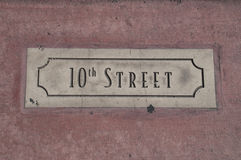 Street name sign in the pavement Stock Images