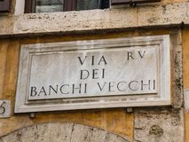Street name sign of Via dei Banchi Vecchi in Rome, Italy. Historical street close to Piazza Navona and the Vatican royalty free stock photography
