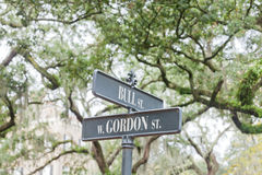 Street name signs Historic District Savannah GA US. Street name signs of Bull Street corner West Gordon Street under oak trees of Monterey Square in Historic Royalty Free Stock Images
