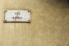 Street with the name of Via Roma in Sicily, Italy. Street with the name of Via Roma on a plate in the old town of Corleone, a town known for associating with the Stock Image