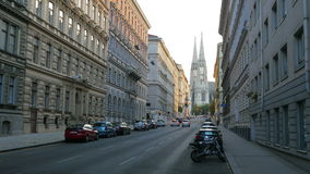Street near freud museum, votive church at background, vienna, austria stock footage