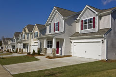 Street of new affordable houses. Street of new affordable suburban houses royalty free stock images