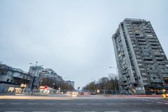 Street in New Belgrade with tall residential buildings aging from the communist period built on the side. stock photo