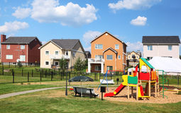 Street of new cottages with playground Stock Photos