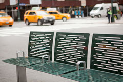 Street of New York with bench and taxis Stock Photo