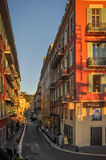 Street in Nice, France: French Riviera. A typical narrow street in Nice, France at sunset near Place Massena. A famous place in French Riviera. Traditional Stock Image