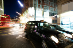 Street at night. Abstract picture of Busy high street in London at night stock photo