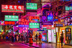 Street at night with illuminated advertisings in Hong Kong Royalty Free Stock Images