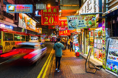 Street at night with illuminated advertisings in Hong Kong Stock Images