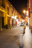 Street at night in the old district of Macau Stock Photo