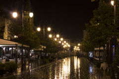A street in the night and storm. A street during the rain enlightened with street lights Stock Images