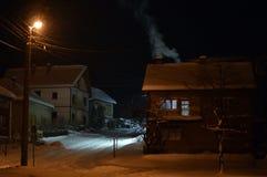 Street at night under snow Royalty Free Stock Image