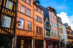 Street in Normandy. Photo of colorful, vibrant houses in Normandy Royalty Free Stock Image