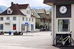 Street of a Norwegian town among mountains Stock Photo