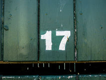 Street Number, 17 on Wooden Background Royalty Free Stock Images