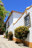 Street of Obidos. Traditional white house in Obidos, Portugal stock image