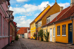 Street in Odense. A Cobbletone Street In Odense with Coloured Houses royalty free stock images