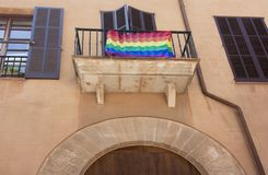 Street and old building with rainbow flag in the historic city center of Palma Mallorca, Spain 30.06.2017. Stock Images