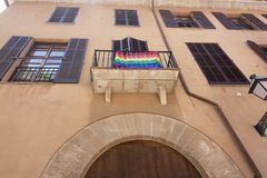 Street and old building with rainbow flag in the historic city center of Palma Mallorca, Spain 30.06.2017. Stock Image