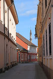 Street with old buildings and minaret Eger Royalty Free Stock Photo