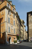 Street and old buildings in Rome. Street scene in Rome, with old buildings and modern forms of transportation Royalty Free Stock Image