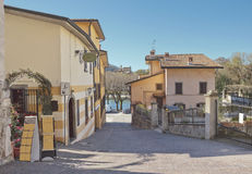 Street with old buildings in Sarnico, Lombardy, Italy. Picturesque street with old buildings in Sarnico, Lombardy, Italy in spring Royalty Free Stock Photography