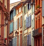 Street with old buildings in Toulouse. Narrow historic street with old buildings in Toulouse, France Stock Images