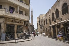 Street in Old Cairo with minaret in the background Royalty Free Stock Image
