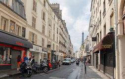 Street in old center of Paris with walking people and Eiffel Tow Stock Images