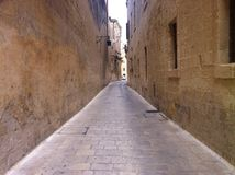 Street in the old city. Getting lost in a Medieval street Royalty Free Stock Photography