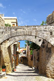 Street of the old city of Rhodes with lintels protecting from ea. Rthquakes. Greece Stock Images