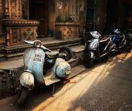 Street of Old Delhi. Scooty near the haveli royalty free stock image