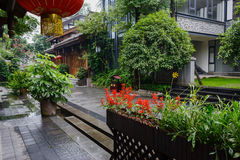 Street between old-fashioned Chinese buildings on rainy day Stock Photography