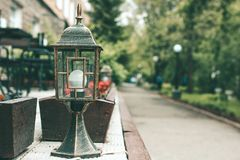 Street old fashioned lamp in the pedestrian street. Blurred walking street on the background. royalty free stock images