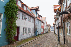 Street in old Flensburg, Germany. Street view with traditional colorful living houses along the street in old Flensburg, Germany Stock Photos
