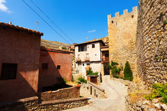 Street with old fortress wall in Albarracin Stock Photography