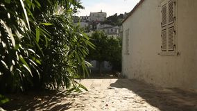 Street of the old Greek town. Paving in old city stock video footage