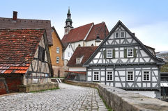 Street  with old half-timbered houses and the church. The walking street of Waiblingen with old half-timbered houses and the church.  Baden-Wurttemberg, Germany Royalty Free Stock Images