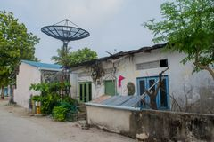 Street with old house and trees at the tropical island Fenfushi Stock Images