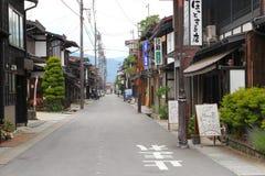 People billboards street old village Hida Furukawa, Japan stock photography