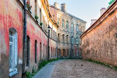 Street with old houses and cobblestone Old City Vilnius Lithuania. Street with old houses and cobblestone in the historical part of the Old City of Vilnius, in royalty free stock photo
