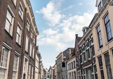 Street with old houses under blue cloudy sky. Deventer, Overijss. Street with old houses under a blue cloudy sky. Deventer, Overijssel, Netherlands Royalty Free Stock Images