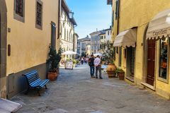 On the street in old medieval village Castellina in Chianti. Tuscany. Italy. Castellina in Chianti, Italy - September 29, 2018: On the street in old medieval royalty free stock images