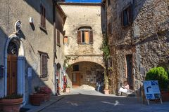 On the street in old medieval village Castellina in Chianti. Tuscany. Italy. Castellina in Chianti, Italy - September 29, 2018: On the street in old medieval stock images