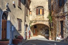 On the street in old medieval village Castellina in Chianti. Tuscany. Italy. Castellina in Chianti, Italy - September 29, 2018: On the street in old medieval stock photo