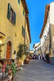 On the street in old medieval village Castellina in Chianti. Tuscany. Italy. Castellina in Chianti, Italy - September 29, 2018: On the street in old medieval stock photos